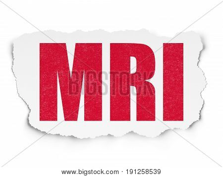 Health concept: Painted red text MRI on Torn Paper background with  Tag Cloud