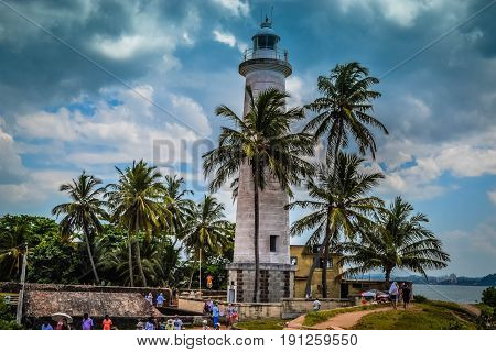 White Lighthouse on the shore in Galle Sri Lanka