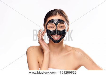 Woman smiling, woman in cosmetic mask for face on isolated background.