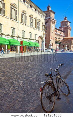 Ferrara Italy - July 21 2011: View of Martiri della Libertà street with the Estense castle in the background