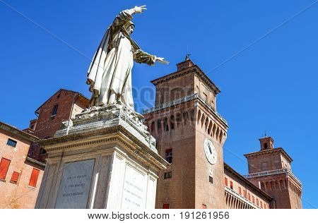 Ferrara Italy - July 21 2011: The Estense castle with the Savanarola monument in the foreground