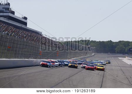 June 11, 2017 - Long Pond, PA, USA: Kyle Busch (18) leads the field to turn one during the start of the Pocono 400 at Pocono Raceway in Long Pond, PA.