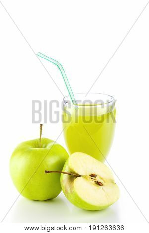 Apple juice in glass and green apples. Isolated on white background.