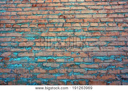 Brown blue background of a brick wall on the facade of a residential building