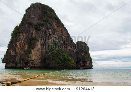 Travel To Krabi, Thailand. The Scenic View On The Sea And A Rock From Phra Nang Beach.