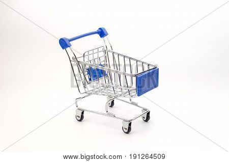 mini supermarket shopping cart blue color on white background holiday sale and online shopping concept selective focus copy space
