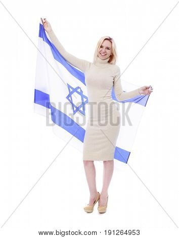 Happy blonde girl with Israeli flag. Happy young women holding flag of Israel while standing against white background