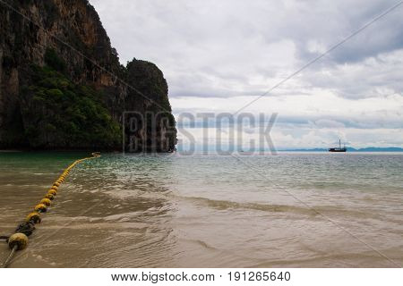 Travel To Krabi, Thailand. The Scenic View On The Sea And A Rock From Phra Nang Beach In The Cloudy