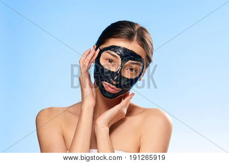 Problem with skin, woman in cosmetic mask on blue background.