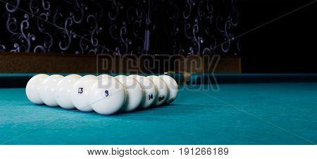 eight white billiard ball on a pool table