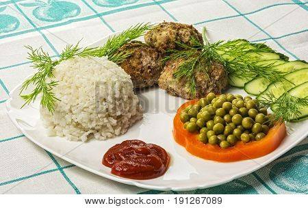 Food. Meat cutlet with boiled rice and vegetables
