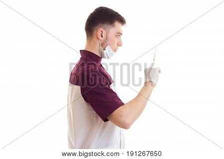 nice young intern holding a syringe isolated on white background