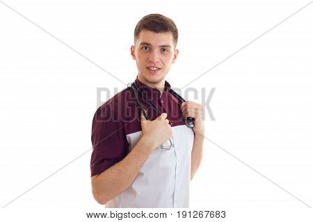 a young doctor with stethoscope uniform smiles at the camera isolated on white background