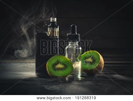 Black Vaporizer In The Smoke With Sliced Kiwi