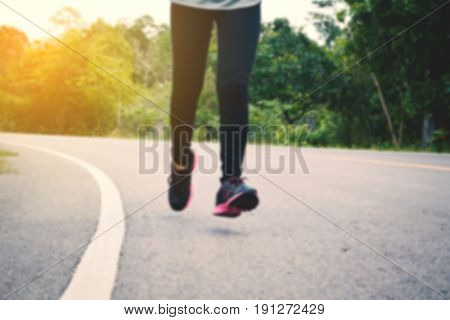 Women running on the road for healthvintage tone and blurred focus