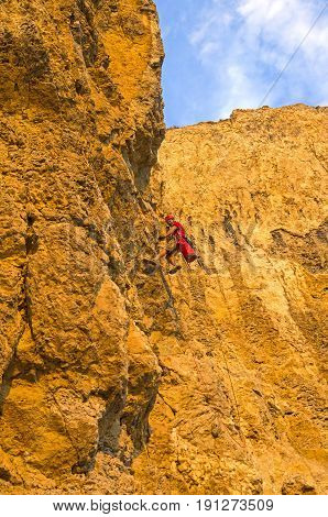 Cape Alchak Crimea August 17 2016: Rock climber on a steep rock.