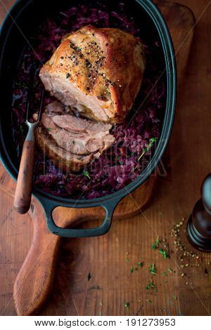 Roasted duck on rustic wood table with cabbage