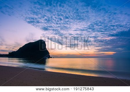 mountain silhouette seascape beach and clous morning summer