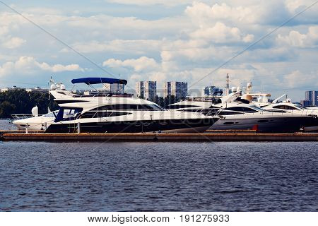 Luxurious yacht for walks and excursions is prvvartovana in Moscow river, Russia. Concept travel in Moscow and St. Petersburg. Shine of the sun.