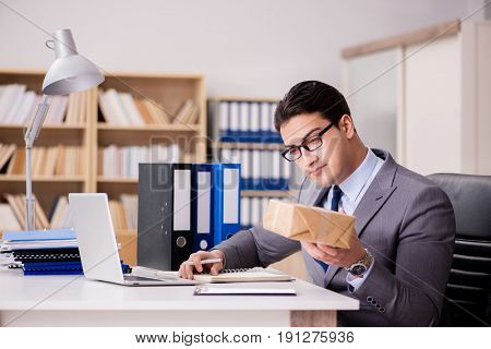 Businessman receiving parcel in the office