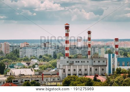 Gomel, Belarus. Aerial View Of Cityscape And Thermal Power Plant Of  Republican Unitary Enterprise Of Power Industry Gomelenergo In Sunny Blue Sky In Summer Day