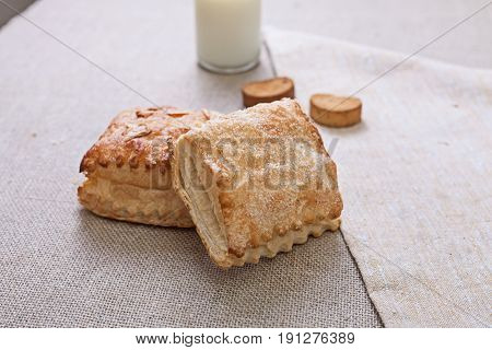 Fresh roll with sugar. View from above. Warm fresh bread.