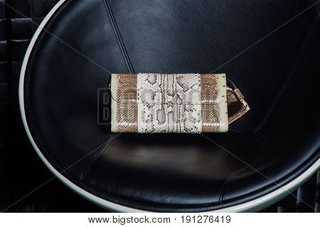 compact modern leather female clutch with print