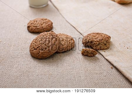 Oatmeal cookies close-up. Cookies on a table with a rough tablecloth. Pieces of cookies.