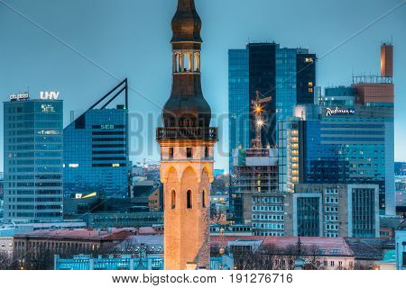 Tallinn, Estonia - December 3, 2016: Tower Of Town Hall On Background With Modern Urban Skyscrapers. City Centre Architecture. Headquarters Of LHV and SEB Bank, Swissotel Tallinn, Radisson Blu Hotel