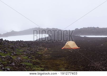 Wild Camping In Iceland Lava Field. Early Morning Mist Over Black Landscape Of Saefellsnes, Western