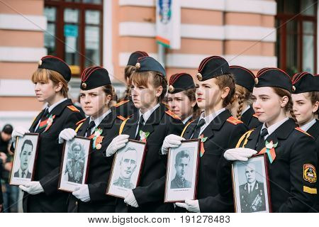 Gomel, Belarus - May 9, 2017: Marching Formation Of Cadet Girls From Gomel State Cadet School With Portraits Of Great Patriotic War Heroes In Parade Procession. Celebration Of Victory Day 9 May