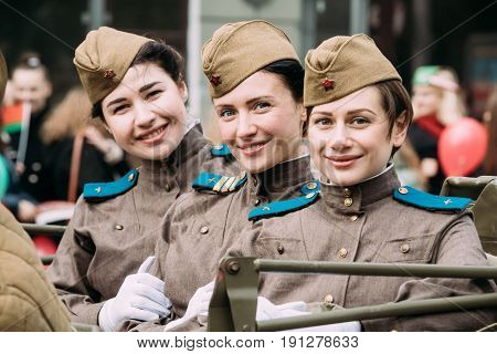 Gomel, Belarus - May 9, 2017: Young Women Girls Re-enactors Dressed As Russian Soviet Red Army Soldiers Of World War II Taking Part In Parade In During Celebration Of Victory Day 9 May