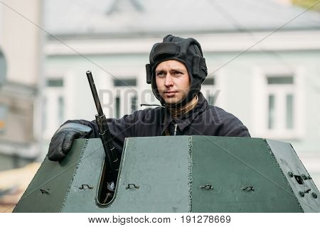Gomel, Belarus - May 9, 2017: Re-enactor Dressed As Russian Soviet Crew Member Of World War II Sitting In Armoured Soviet Scout Car BA-64 And Taking Part In Parade During Celebration Of Victory Day