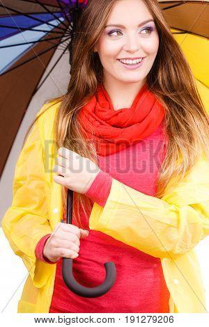 Woman In Rainproof Coat Under Umbrella