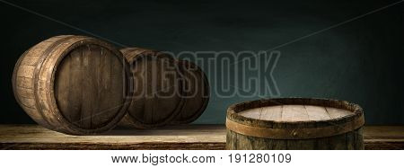 corkscrew and wooden barrel, vineyard on background.
