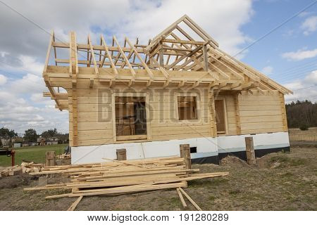 View on Wooden house under construction. Poland.