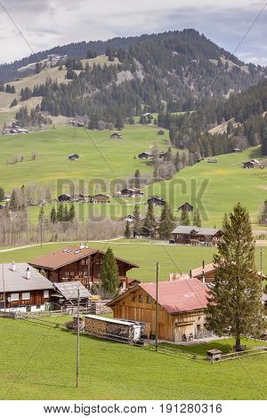 Typical Swiss village on valley - Europe.