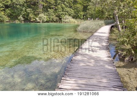 UNESCO National Park in Croatia. Plitvice Lakes. Wooden narrow pathway.