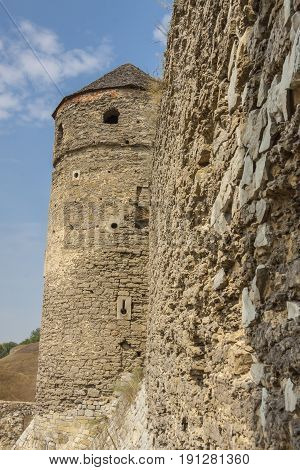 Tower and detail of wall - castle in Kamianets Podilskyi. Ukraine Europe.