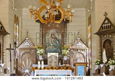 OJCOW POLAND - 25 AUGUST: Interior of chapel on water on august 25 2012 in Ojcow. This is old wooden chapel on pillar in mountain brook.