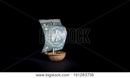 Dollar sailboat with black background ship from the dollar and walnut