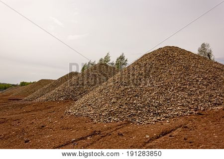 A heap of granite gravel on the construction site poster