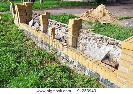 Building Brick Wall for Fence. Bricklaying Fencing.