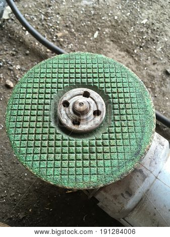 close up grinding machine on the ground