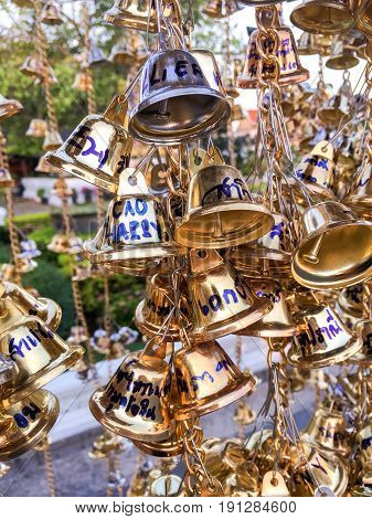 2 April 2017 : close up hanging small gold bells for luck in Wat Chaeng , Bangkok , Thailand