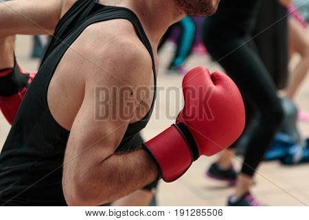 Fitness and Boxing Workout: Boy with Red Gloves