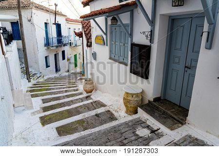 Narrow street with stairs and traditional houses in the old town of Koroni in Peloponnese, Greece