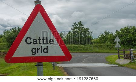 Cattle Grid Sign next to Cattle Grid warning cars to slow down