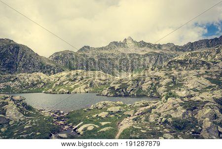 Glacier mountain lake in Brenta Dolomites. Nero lake above Madonna di Campiglio, Italy.