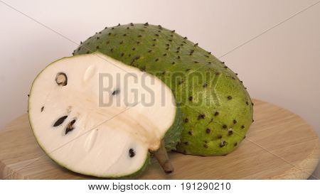 Soursop, Prickly Custard Apple, Annona muricata L with slice on wooden cutting board.